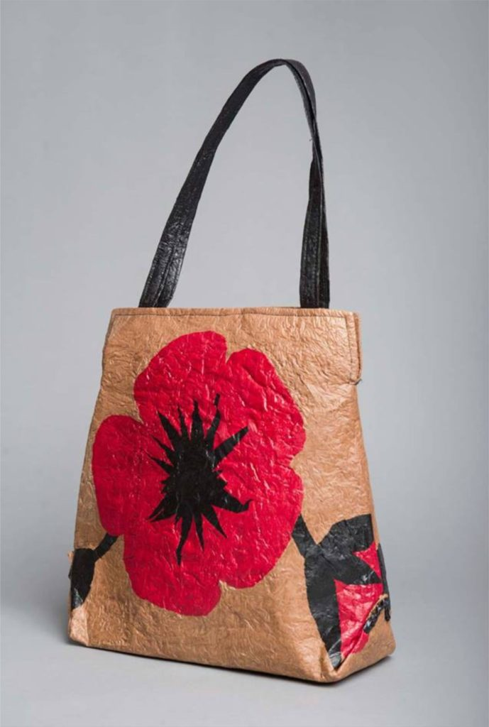 "HFR Designs wearable art ""Poppies"" purse made from plastic bags."