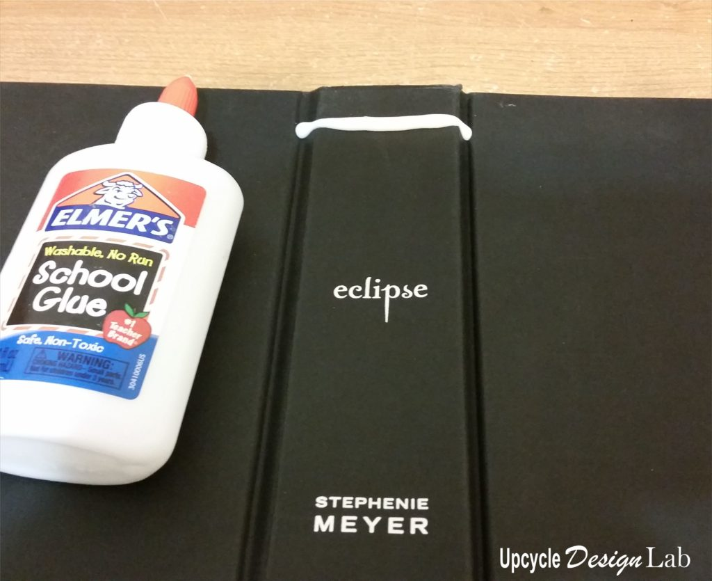 Adding glue to book cover for texture